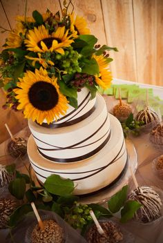 We do cake toppers too! sunflowers and hypericum berries make this an excellent choice for a rustic wedding