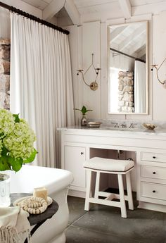 Pretty white bath with pickled walls - love the sconces & the heavy white shower curtain