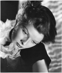"""Trio of Katherine Hepburn oversize gallery portraits by Ernest A. Bachrach. Silver bromide matte 11 x 14 in. master parchment prints (3, ca. 1935) from the personal collection of the photographer. One (striped gown) is numbered in the negative """"NY Q-323""""."""