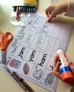 Great word work station for Kinders. Includes black and white and a color option that you can laminate and use with a dry erase marker.