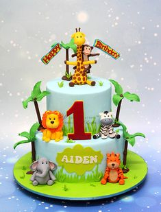 One of my favorites for the kiddos, a Jungle Theme Cake. The two tier birthday cake was decorated with cute animal toppers. Jungle Safari Cake, Jungle Birthday Cakes, Jungle Theme Cakes, Baby First Birthday Cake, Safari Theme Birthday, Animal Birthday Cakes, Safari Cakes, Themed Birthday Cakes, Themed Cakes