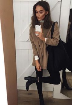 Tan sweater over white shirt with black skinny jeans.
