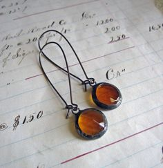 Amber faceted glass nuggets with a flat back are soldered and finished with an antique patina. These vintage inspired glass nuggets measure
