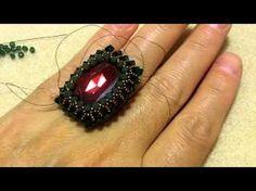 #DIY - How to bezel a 27x13mm Swarovski square cabochon - SIDONIA PETKI - materiais: One 27x13mm Red magma cabochon; 3mm Emerald and Palace green opal Swarovski bicones; 15/0 Miyuki seed beads cod - 2006; 0.15 Smoke Fireline