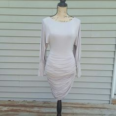 bebe cocktail dress This is an absolutely gorgeous gray dress! It hugs your curves in all the right places. You can wear it for a night out at the club or dress it up for a semi-formal event!    ~ Back zip ~ Fully lined ~ Round neckline bebe Dresses Midi