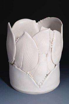 Hosta Vase handbuilt using porcelain clay and Hosta Leaves from my garden.