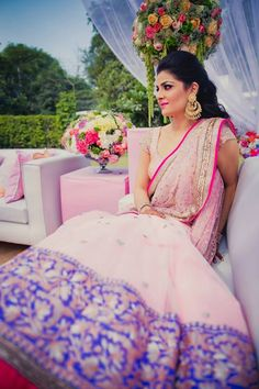 Indian bride wearing bridal lehenga for mehndi or henna