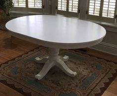 Crate and Barrel white extension dining table in Richmond, VA (sells for $300)