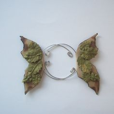 Elf Ear Cuffs, Woodland, Fairy Wings in Tan with Green Leaves. $10.00, via Etsy.