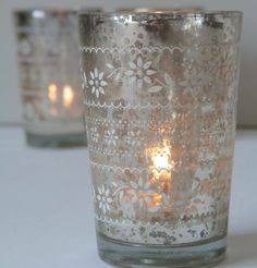 two antiqued silver glass tea light holders by the lovely light company | notonthehighstreet.com