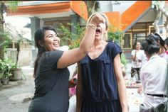Staff member Putu goofing around with the founder of the NGO VP Bali Kimberley in one of our schools.