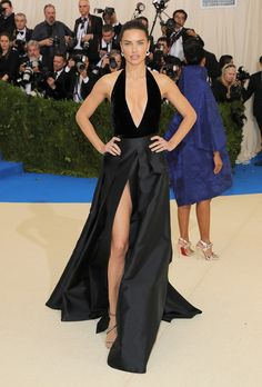 Adriana Lima keeps the deep-V trend going strong (see also Behati Prinsloo-Levine, Joan Smalls, and Sofia Richie) in a silky black number with a plunging neckline and thigh-high slit.