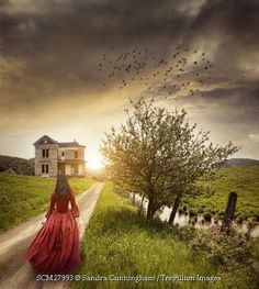 Trevillion Images - woman-in-red-dress-on-path-by-house