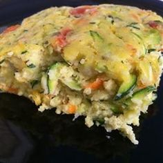Healthy Breakfast Zucchini Bake Made this and it was delicious!  Moist, tender, full of veggies.  Somewhere between the texture of a biscuit and a souffle with a whole lot more flavor.  I thinly sliced 1.5 zucchinis and grated the rest and replaced the herbs with fresh basil.  Nom!