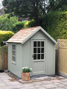 Built my shed in Posh Shed Company-style with cedar roof shingels and painted it in Farrow and Balls Lichen colour. – de is gardening Painted Garden Sheds, Painted Shed, Backyard Sheds, Outdoor Sheds, Outdoor Storage Sheds, Shed Building Plans, Shed Plans, Posh Sheds, Log Cabin Sheds