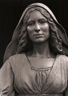 The Mother of the Church sculpture is a seven foot bronze sacred art monument located in the St. John the Evangelist Cathedral in downtown Milwaukee.