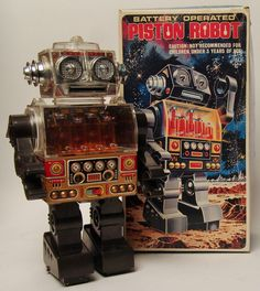 This 12 inch tall robot is in excellent condition. Works great with forward walking action, and lighted piston engine in the chest! Scarce round eared version.The original box is in good condition wit
