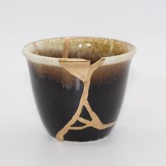 Kintsugi is the Japanese art of repairing broken objects with gold. The flaw is seen as a unique piece of the objects history which adds to its beauty and strength. Consider this the next time you are feeling broken.  Beautiful Japanese Kintsugi Sake Cup  Dimensions: 3 Diameter, 3 1/4 Height