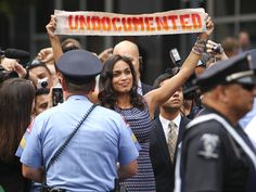 American actress Rosario Dawson holds up a banner for a DREAM Act Bus protest. Dawson is of Afro-Puerto Rican and Afro-Cuban descent. #undocumented #feminism #activism