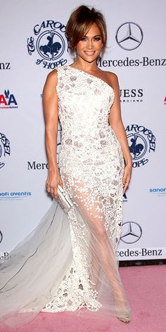 Jennifer Lopez in a Georges Chakra Couture gown, Neil Lane diamonds and a Daniel Swarovski clutch