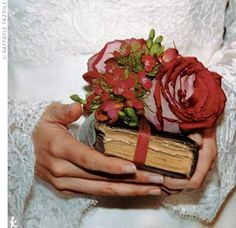 """Instead of a bouquet, Cheri carried her grandmother's missal, covered with flowers. Someone else also suggested something similar: """"Instead of a bouquet, I carried my favorite book wrapped in something borrowed—a friend's blue-embroidered handkerchief. I called it my 'book-quet.'"""" #diy #flowers"""