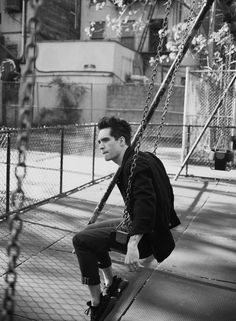 Brendon Urie on a swing<<< he looks like he's waiting to swing with Ryan