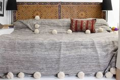 Moroccan Pom Pom Blanket Throw Bedspread, Hand woven with Pure Organic Hand Spun Wool, Cozy Warm Bedding, Ivory White & Grey. (BW9). ● CRAFTSMANSHIP - Exquisite Moroccan pom pom blanket throw adorned with oversized pom poms on top and bottom fringe. Hand spun with organic wool, sheared from live sheep that roam foothills of Morocco's High Atlas Mountains (exclusive to Berber Wares). Hand woven on traditional wooden looms by skilled artisans at our Marrakech atelier ● SUPERIOR QUALITY -...