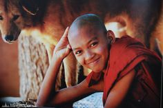 A smilley Burmese monk kid in Mandalay