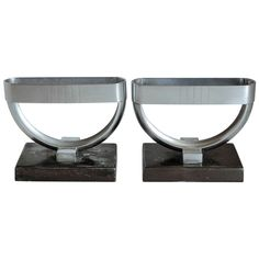 Rare Pair of Revere Crescent Candlestick Holders by Norman Bel Geddes | From a unique collection of antique and modern candle holders at https://www.1stdibs.com/furniture/decorative-objects/candle-holders/