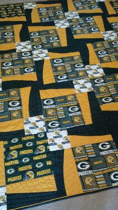 Packers quilt using Maple Island BQ3 pattern and faux piped binding.