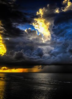 opticallyaroused:  Big storm, golden sunset, gorgeous sky, calm ocean, what a day !