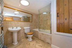 Large family bathroom, sun tunnel, travertine stone, Dulux Natural Hessian, cottage for sale Exposed Brick Walls, Exposed Beams, Dulux Natural Hessian, Family Bathroom, Family Room, Grey Painted Walls, Log Burning Stoves, Window Seat Storage, Multi Fuel Stove