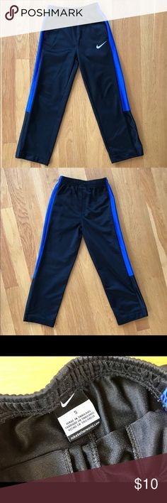 Boy's ✔️ NIKE Pants Black and blue Nike pants with side pockets. Wonderful pre loved condition. Nike Bottoms