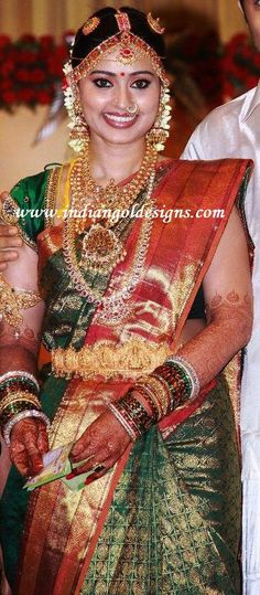 checkout sneha in green bridal kanchipuram silk saree with heavy zari work throughout the saree and paired with red rich zari...