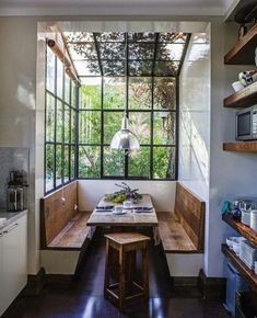 Beautiful sunny kitchen nook with wood benches and lots of windows