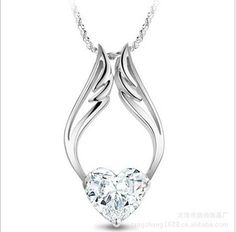 Purchase White Gold Plated Guardian Angel Wing Necklace with a Swarovski Elements Heart Pendant. from Marcus Emporium on OpenSky. Share and compa Crystal Pendant, Crystal Necklace, Sterling Silver Necklaces, Pendant Jewelry, Pendant Necklace, Necklace Chain, Guardian Angel Necklace, Angel Wing Necklace, Fashion Necklace
