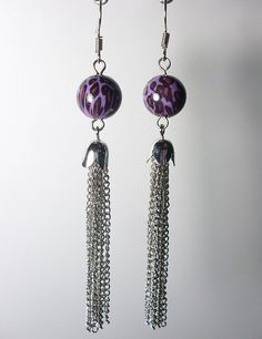 Purple Leopard Earrings! With Chain Tassels. Original and Funky fashion! Punk love and a Rad Style. One of 6 colors! Comes with Silver hooks link: Purple Leopard Earrings! With Chain Tassels. Original and Funky fashion! Punk love and a Rad Style. One of 6 colors! Comes with Silver hooks link: https://www.etsy.com/ca/listing/202618997/purple-leopard-earrings-with-chain?ref=shop_home_active_2
