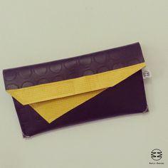 MARIA MARINO bag_pochette in linoleum bullonato nero e inserto triangolare giallo. Chiusura bottone calamita. Per info: http://marinomaria.blogspot.it/