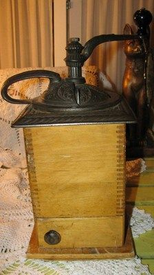 beautiful!!! 14 in tall to top of handle! has original tin cup. side opening door. Grrreat coffee grinder