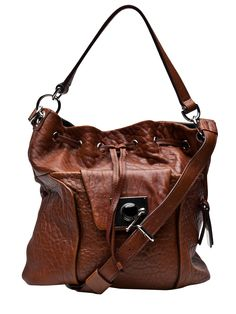 Olivia Harris' distressed bags are a perfect balance of structure and bohemian-luxe.