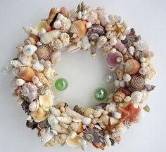 "Beach decor seashell wreath. Nautical decor shell wreath in brightly colored natural shells, Coastal decor shell wreath, 12""  $120.    https://beachgrasscottage.com/collections/wreaths/products/custom-sg-wreath"