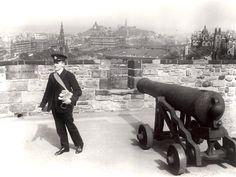 A photo from the Royal Mail Archive - a postman stands beside a cannon at Edinburgh Castle, Best Of British, Edinburgh Castle, Royal Mail, Northern Ireland, Cannon, Great Britain, That Way, United Kingdom, Archive