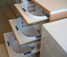 Take a sliding drawer cabinet and cut a hole for you luandry baskets. Helps eliminate luandry sorting hassle.