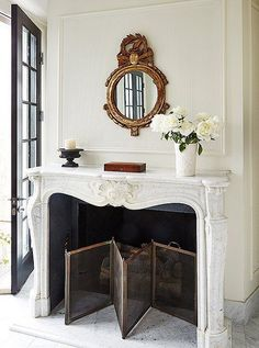Fabulous home and interior design by Darryl Carter. Love his simply, elegant, classical style. Gorgeous fireplace mantel and surround.