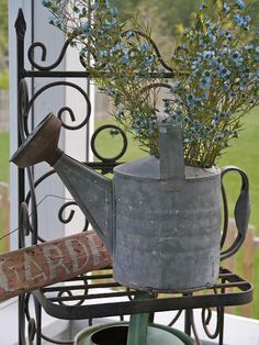 Love the flowers in the old watering can......