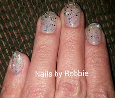 Green and blue flake glitter from Gelish and black and white speckled glitter OPI gel polish.