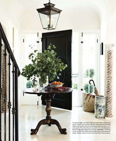 An antique pedestal table in the foyer sets the homes casual tone