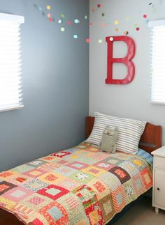 I like the single distressed letter above bed