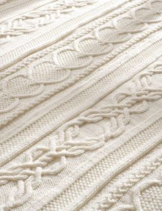 Free Knitting Pattern for Gift of Love Cable Afghan - Chain of Hearts cables alternate with Lovers Knot Cables to create an heirloom blanket perfect for wedding gift, Valentine's Day, or other celebration of love. Knit in panels and seamed. Designed by Bernat Design Studio