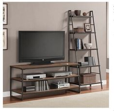 Entertainment center wheels ladder centers large modular wall home industrial stands loft style iron with sta . rustic entertainment center with wheels Bookshelves With Tv, Bookcase Shelves, Ladder Bookshelf, Pipe Shelves, Steel Furniture, Living Room Furniture, Living Room Decor, Regal Display, Tv Stand Shelves